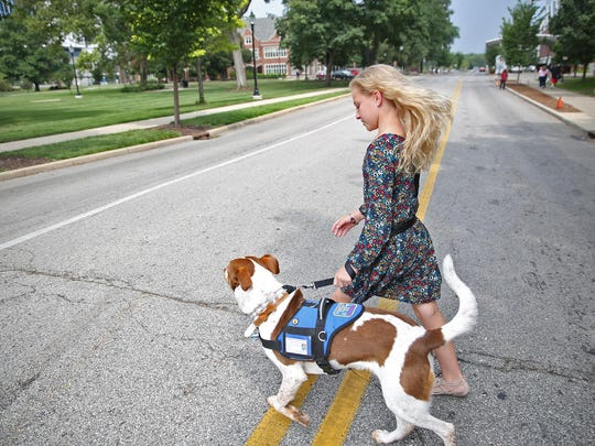 Gracie walks with Brystin Fleetwood outside Riley Hospital for Children at IU Health on Aug. 10, 2016.