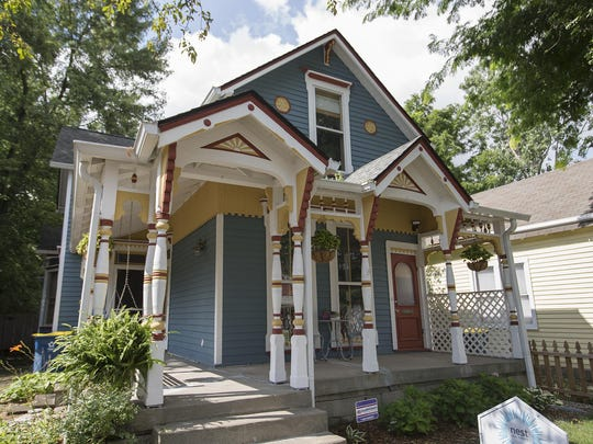 Rob and Erin Till repainted the exterior of their 1,889-square-foot home in the 1200 block of East 10th Street in the Cottage Home neighborhood.