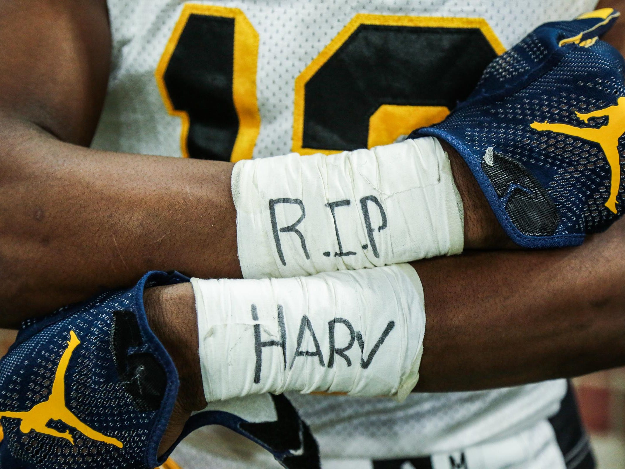 "Jesse Scarber shows his taped wrists with ""R.I.P Harv"" for King coach Dale Harvel, who passed away before the season."