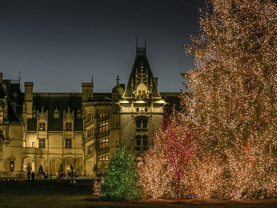 This Nov. 4, 2016 photo shows a massive Christmas tree covered in lights outside The Biltmore House in Asheville, North Carolina. Christmas at The Biltmore continues a holiday tradition that started in 1895 when George Vanderbilt opened the 250-room mansion to family and friends. Attractions this year include more than 70 decorated trees, hundreds of poinsettias and garlands, a 34-foot-tall fir tree in the banquet hall and a 55-foot Norway spruce on the front lawn. (LeeAnn Donnelly/The Biltmore via AP)