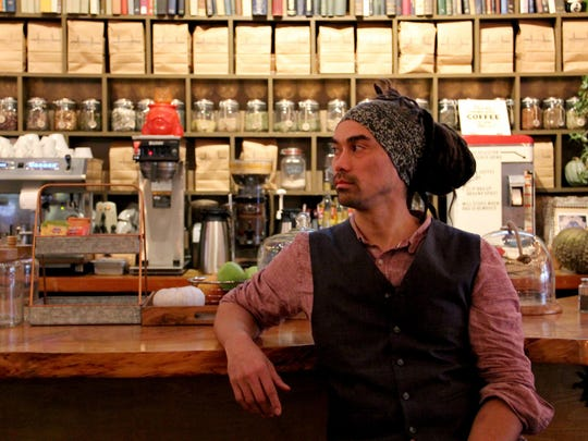 Christopher Holland, the owner of Taproot Lounge and Cafe.