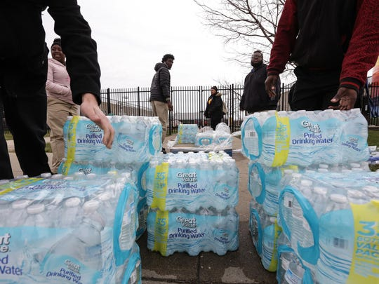 This file photo shows Flint / Genesee County Job Corps Center students gather cases of water to distribute to those in need during the Flint water crisis in March 2016.