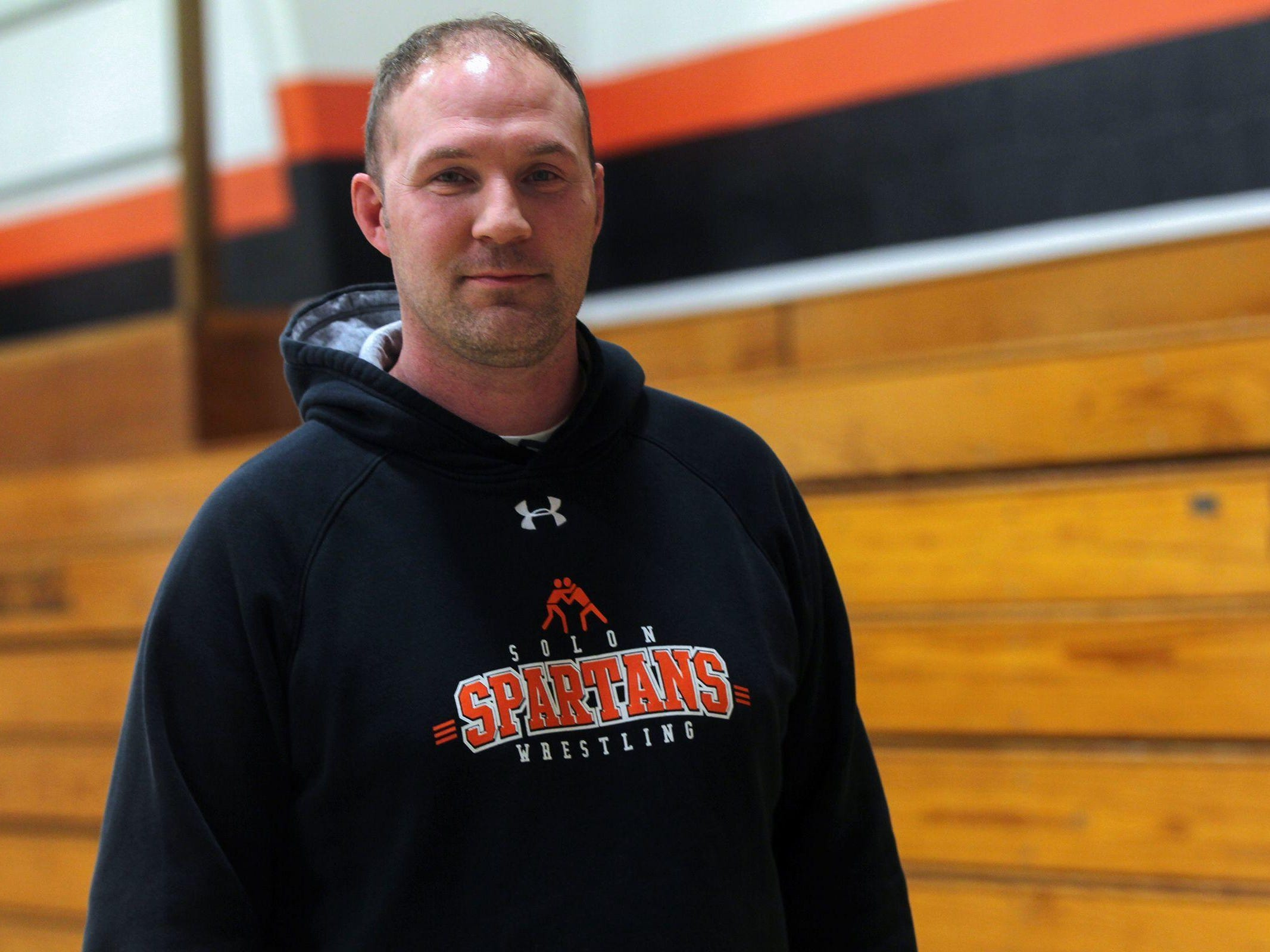 Solon wrestling head coach Blake Williams poses for a photo on Wednesday, March 1, 2017.