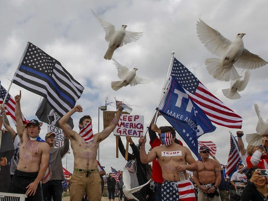 Supporters of President Trump during a Make America Great Again March on Saturday, March 25, 2017, in Huntington Beach, Calif.