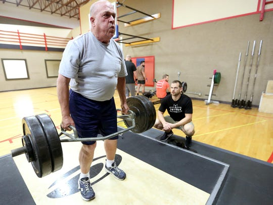Mike Shea, 73, of Salem, deadlifts 240 pounds during a personal training session with Head Trainer Kyle Davey at Courthouse Fitness on River Road S.