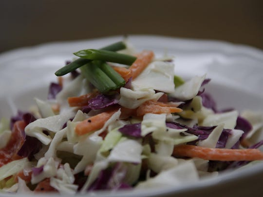 Coleslaw with Creamy Poppy Seed Dressing gets a pop of color and phytonutrients from purple cabbage.