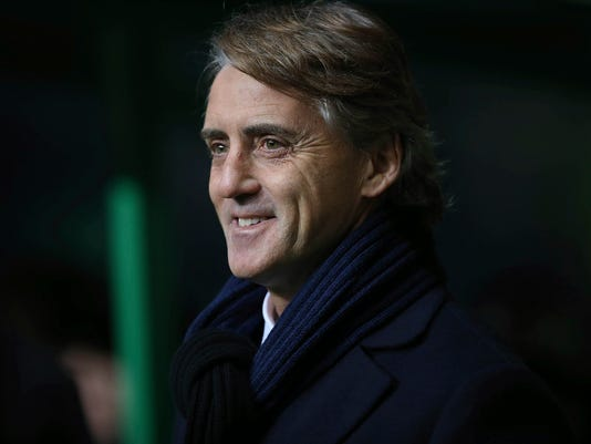 """FILE - In this Thursday, Feb. 19, 2015 file photo, Inter Milan's manager Roberto Mancini awaits the start of their Europa League first leg of round of 32 soccer against Celtic at Celtic Park, Glasgow, Scotland. Mancini has signed a three-year contract to coach Russian club Zenit St. Petersburg. Mancini hailed his Zenit post, the Italian's first job since leaving Inter Milan in August, as """"a new adventure,"""" in comments on Twitter on Thursday, June 1, 2017. (AP Photo, File)"""
