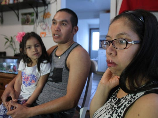 Carlos Larios, Angelica Avila with their daughter Kimberly Larios speak during an interview in their Long Branch home. Both are Guatemalan nationals who illegally entered the U.S. and have lived here for more than a decade.