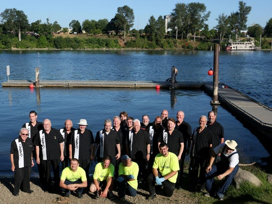 The SenateAires stand near the Willamette River before rehearsing for Harmony on the Water, a cruise, concert, dinner and history experience with the Willamette Queen and the SenateAires. The event will run every other week July 20-Sept. 7.