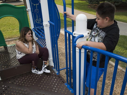Former Fort Collins residents Sara Mondragon and her little brother Mike Griego, 10, play on the playground where their grandmother Kathy Mondragon used to take them, Wednesday, August 6, 2017, at Spring Park in Fort Collins, Colo.
