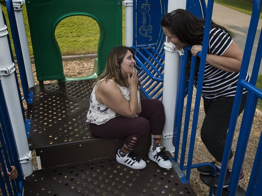Former Fort Collins residents Sara Mondragon and her mother Shauna Mondragon hang out on the playground where Sara's grandmother Kathy used to frequently take the children of the family, Wednesday, August 6, 2017, at Spring Park in Fort Collins, Colo.