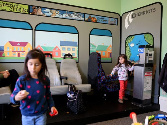"""May Lucas, left, 5, and her sister, Ava Lucas, 2, both of Keizer play in """"Salem Station,"""" a new exhibit at the Gilbert House Children's Museum in Salem. The transportation exhibit opened Nov. 3 and features equipments from Cherriots and Amtrak Cascades."""