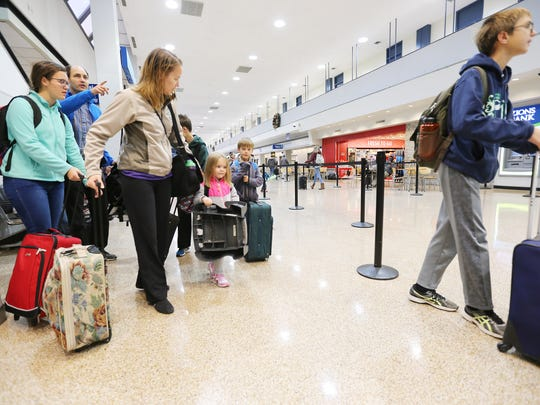 Ryan and Malauna Biggy of Boise head for the security screening area with their family at the Salt Lake City International Airport on Monday, Nov. 21, 2016.