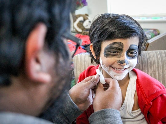 James Estrada applying make-up to his son Joh at their home in Salt Lake City on Monday, Nov. 6, 2017.