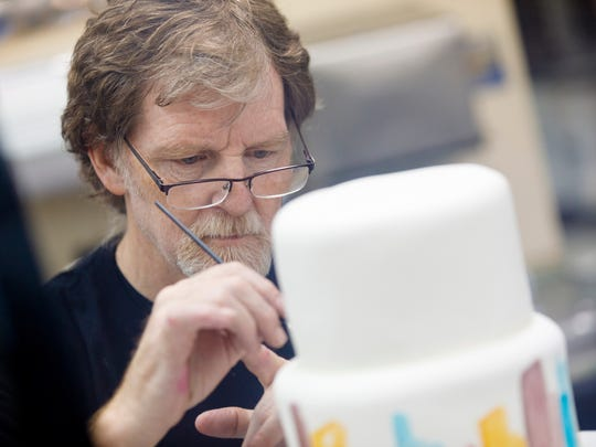 Jack Phillips, owner of Masterpiece Cakeshop in Lakewood, CO decorates a cake for a client on Sept. 21, 2017.  Phillips refused to bake a cake for a same-sex couple in 2012 and is now taking his case to the Supreme Court following the Colorado Civil Rights Commission's ruling that he bake cakes for same-sex couples or not bake wedding cakes altogether.