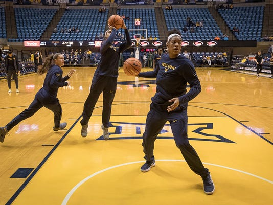Members of the West Virginia team warm up before an NCAA college basketball game against Baylor in Morgantown, W.Va., Sunday, Jan. 28, 2018. (AP Photo/Michael Switzer)