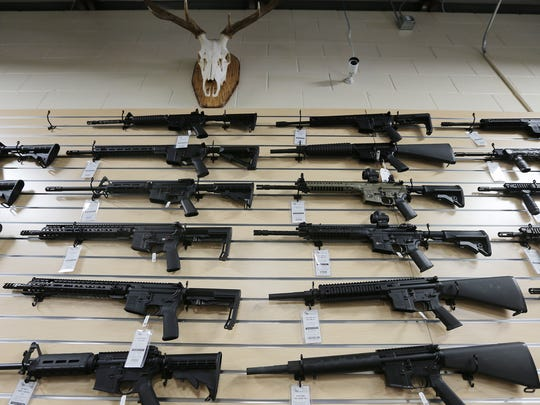AR-15 rifles are displayed at Impact Guns in Ogden on Friday, March 2, 2018.