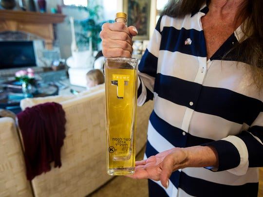 Laura Green showcases her Trump vodka bought from Jerusalem at her home in Sandy on Sunday, Sept., 9, 2018.