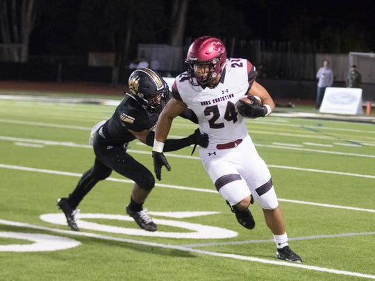 Oaks Christian's Zach Charbonnet gets away from a Calabasas defender during a game earlier this season. Oaks Christian and Calabasas have reached the semifinals in their respective divisions despite dealing with two tragic events. (Photo: Marvin O. Jimenez/Special to The Star).