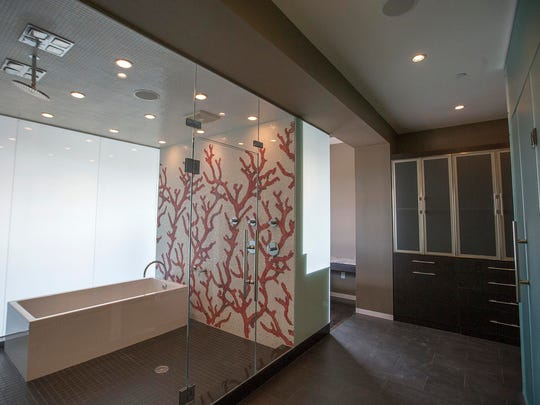 This master bathroom features a hand-painted accent wall.