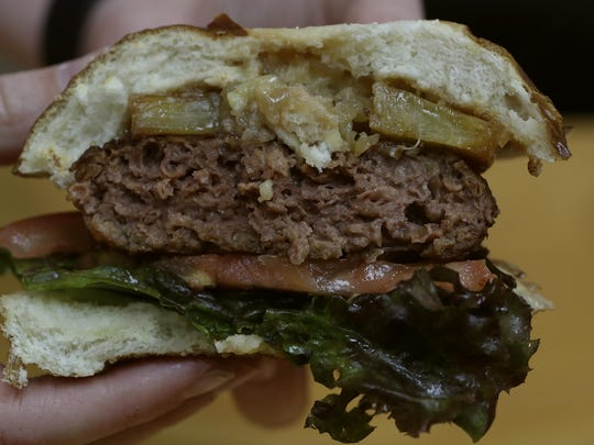 A Beyond Meat hamburger patty is seen in El Segundo, Calif., in this January 30, 2018, file photo. Beyond Meat Inc., the maker of vegan chicken and beef substitutes, is seeking to raise as much as $184 million in its initial public offering.