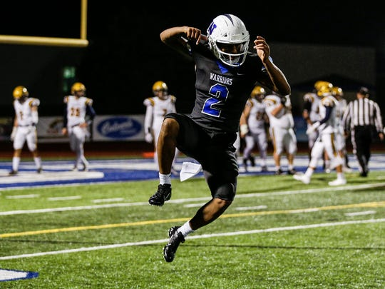 Walled Lake Western quarterback Abdur-Rahmaan Yaseen (2) celebrates a touchdown pass he made against South Lyon during the second half at Walled Lake Western High School in Walled Lake, Friday, Oct. 11, 2019. (Photo: Junfu Han, Detroit Free Press)