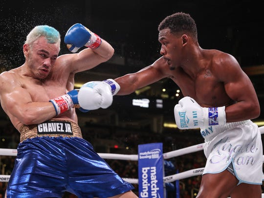 Julio Cesar Chavez Jr. (left) quit after the fifth round against Daniel Jacobs on Friday in Phoenix, sparking a near riot. Ed Mulholland / Matchroom Boxing USA