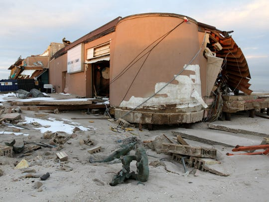 AFTER SANDY: Owner Joey Barcellona has vowed to rebuild the Surf Club, which had survived dozens of earlier storms.