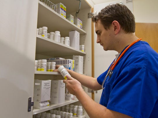 Sean Gowers, R.N., looks over medications in the facilities dispensary room. Partnership Health Center has opened on the campus of Long Branch High School as a medical facility providing health services to the employees of the Long Branch school district and their families. Long Branch, NJ Thursday, October 16, 2014 Doug Hood/Staff Photographer