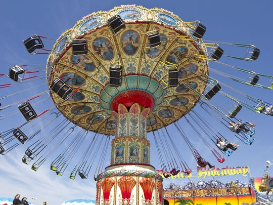 Early-season visitors to the Seaside Heights boardwalk take advantage of sunny, mild weather in April 2014.
