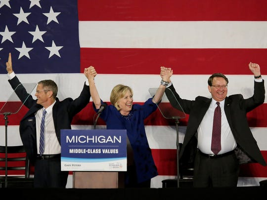 Hillary Rodham Clinton, center, visits Michigan to campaign for Gary Peters for U.S. Senate, right, and Mark Schauer for governor.