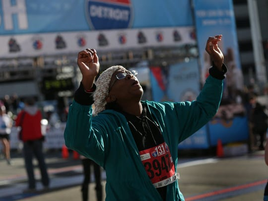 A Leona Burns of Oak Park finishes her half marathon. Some 3,200 runners signed up for those.