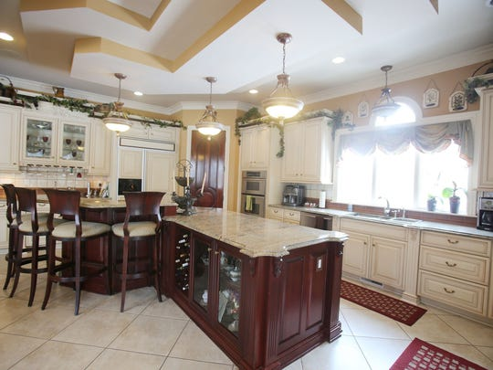 House Envy This is the kitchen in this elaborate Downriver house in Rockwood that is a showplace of Mediterranean style built by a high end builder Giovanna Liparoto who lives in the house with his wife. It is over 8,000 square feet, 5 bedrooms, 4.5 bathrooms on 5.5 acres and listed at $1,735,000.