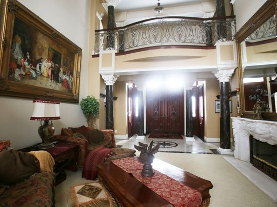 House Envy This foyer opens right into the living room of this elaborate Downriver house near Rockwood. It is a showplace of Mediterranean style built by a high end builder Giovanna Liparoto who lives in the house with his wife. It is over 8,000 square feet, 5 bedrooms, 4.5 bathrooms on 5.5 acres and listed at $1,735,000.
