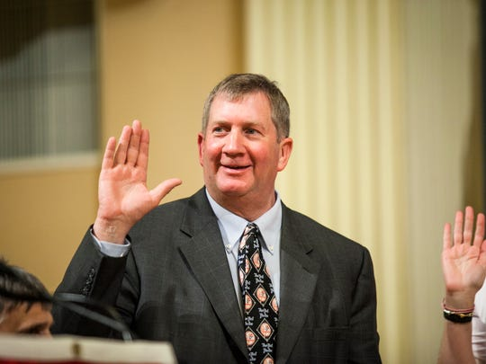 Burlington City Councilor Kurt Wright, R-Ward 4, is sworn in at Contois Auditorium on April 7, 2014.