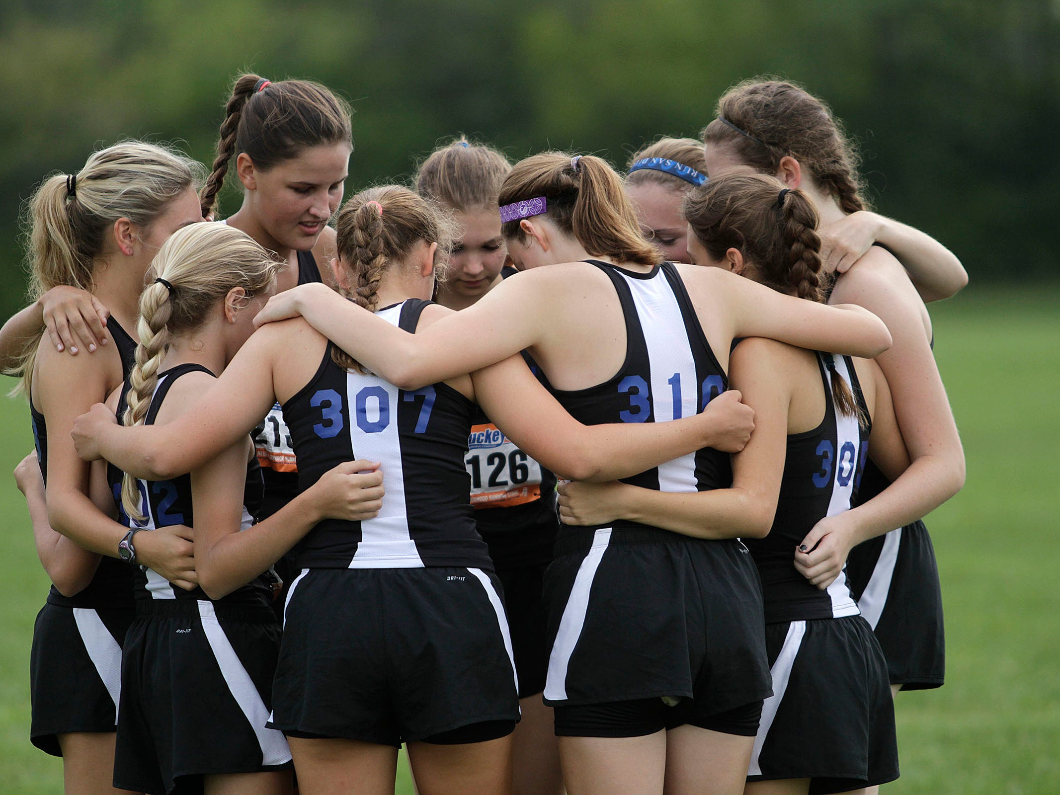 Summit Country Day comes together for a quick motivational word at the Mason Invitational Sept. 6.