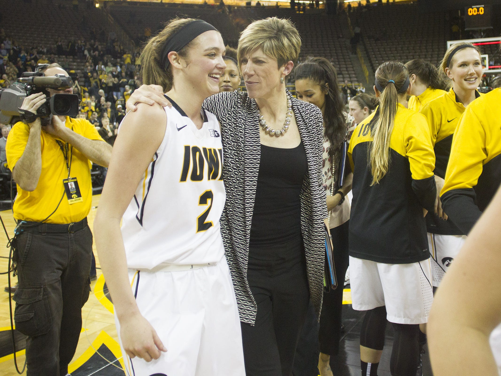 Iowa associate head coach Jan Jensen, right, went to the state girls' basketball tournament in 1987 at EHK. Ally Disterhoft, left, played for Iowa City West at state, winning a title in 2012.