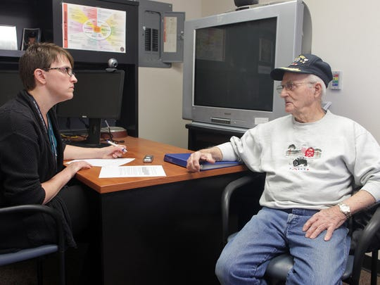 "John Gualtier, 89, speaks with Stephanie Henrickson on Tuesday as part of the ""My Life, My Story"" project at the VA Outpatient Clinic in Coralville on Tuesday."