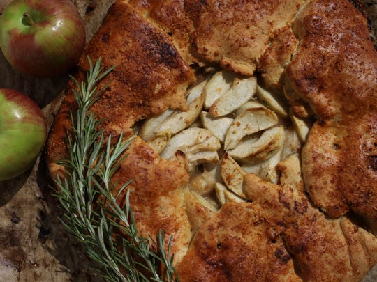 This apple galette has fresh rosemary in the crust and mixed with the apples.