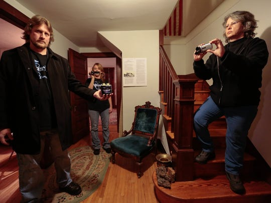 Into the Afterlife Paranormal founder Brian Danhausen of Warren, his wife, group co-founder Darlene Danhausen, and Royal Oak Historical Commission treasurer Candace Isaacson investigate the historic Orson Starr Home in Royal Oak on Wednesday. Royal Oak's leaders said the tours will add up to innocent fun plus potential revenue. The tours are to start in May.