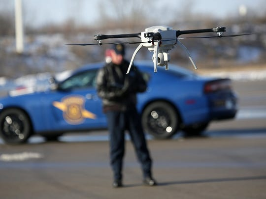 Michigan State Police Pilot Sgt. Matt Rogers flies the department's unmanned aerial vehicle at training headquarters in Lansing. The drone carries a high-definition camera and can fly for about 50 minutes on a single battery charge and withstand wind gusts of up to 40 m.p.h.