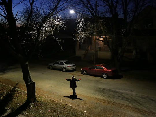 """Claire Nowak-Boyd, 30, rejoices in the brightness of the new streetlight that now breaks the darkness of her street in Detroit near the Hamtramck border. She has lived there two years and says, """"Before they fixed the lights you could tell where Hamtramck started, because it was so much brighter over there,"""" says Nowak-Boyd."""