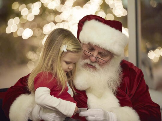 Santa visits Meijer Gardens every Tuesday evening and welcomes all visitors to share holiday wishes and take a picture with him.