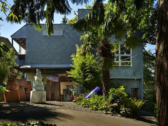 The home, designed by architect Mark Millett, is covered in galvanized-metal scales.