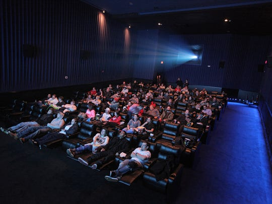 """People fill seats ahead of a sold-out showing of """"The Interview"""" at the historic State-Wayne theater in Wayne on Thursday."""
