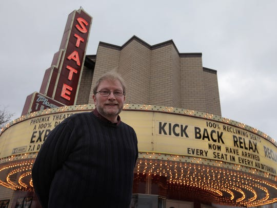 Cory Jacobson, owner of the historic State-Wayne theatre in Wayne, Mich., stands outside before a showing of the film, The Interview on Thursday, December 25, 2014.