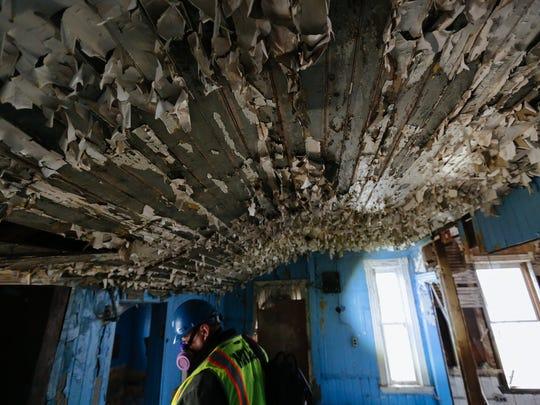 Joseph Goeddeke, with Michigan DEQ, exits an abandoned