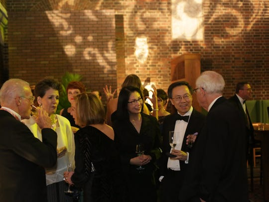 """Guests chat over cocktails during """"A Night of Illusion: The DIA Gala Extravaganza,"""" a benefit dinner at the Detroit Institute of Arts in Detroit on Nov. 8, a day after a judge approved the Detroit bankruptcy plan, ensuring no art would be sold."""