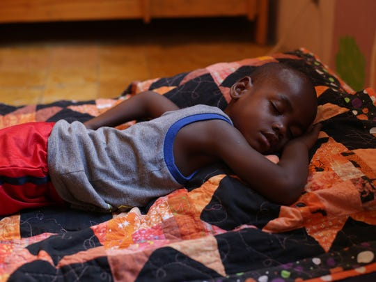 Appolos Knox Joasil, 4 takes a nap after school at The Have Faith Haiti Mission in Port Au Prince, Haiti in November 2014.