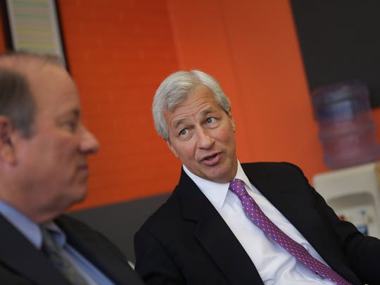 JPMorgan Chase CEO Jamie Dimon, right, and Detroit Mayor Mike Duggan talk to the media at Eastern Market Corp. in Detroit on Wednesday, Feb. 11, 2015.